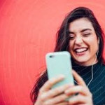 1893927-young-happy-women-video-chatting-with-smart-phone-photocase-stock-photo-large_tcn5b2